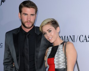 LIAM HEMSWORTH + MILEY CYRUS @ the premiere of 'Paranoia' held @ the DGA theatre. August 8, 2013