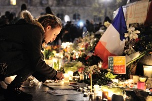 People gather in tribute to the victims of the attacks in and around Paris, at the Place de la Republique in Paris, France, on November 15, 2015. At least 132 people have been killed and over 250 injured, 96 of which seriously wounded, after a series of terrorist attacks in the French capital. Photo by Aurore Marechal/ABACAPRESS.COM